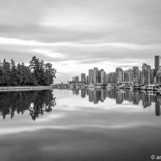Reflection of Stanley Park and Downtown Vancouver (BW)